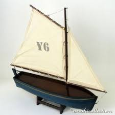 carved ornamental sailing boat in mahogany by lymebaycarvings