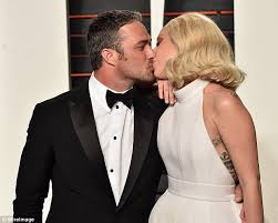 Vanity Lady Gaga Lyrics Lady Gaga Shares A Kiss With Taylor Kinney On Arrival To Vanity