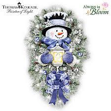 kinkade a warm winter welcome illuminated snowman