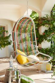 beautiful iron swingasan chair design with blue cushions and