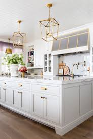 white kitchen cabinets with gold pulls white and gold kitchen design ideas your clients will