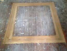 unfinished white oak hardwood border with basket weave corners in