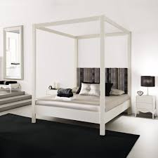 modern white four poster bed juliettes interiors chelsea london