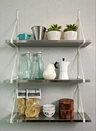 kitchen shelves ideas 3 tiered stainless steel wall mounted kitchen shelves with white