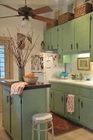 How To Decorate Above Cabinets by Look Up Decorating The Top Of A Cabinet U2013 Interiors By Candice