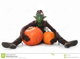 female green goblin with pumpkins halloween stock image image