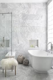 gray marble master bathroom with lucite sputnik flush mount light