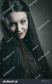 evil smile on beautiful vampire face stock photo 265450478