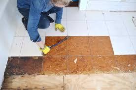 master bathroom removing the floor tile at charlotte u0027s house