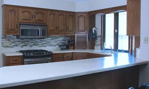 spray paint kitchen cabinets plymouth how to paint cabinets with a paint sprayer