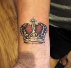 beautiful crown tattoo on wrist