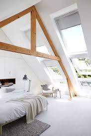 swooning over the oversized slanted windows triangular beams in