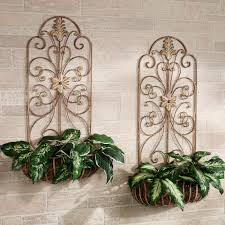 gold polished wrought iron wall planter with carved floral pattern