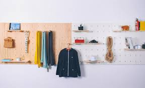 Peg Board Shelves by Modular Shelving Unit Uses Pegs To Support Shelves And Hang