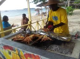 fireman grilling lobster on negril beach foodie pinterest