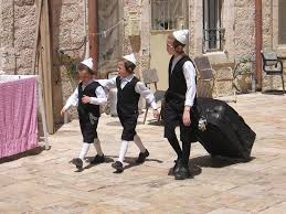 shabbat clothing file toldos aharon kids prepare for shabbat mea shearim jerusalem