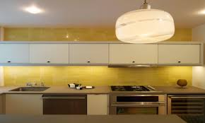 yellow kitchens yellow kitchen tile black and yellow backsplash