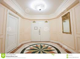 anteroom with double door and mosaic marble floor royalty free