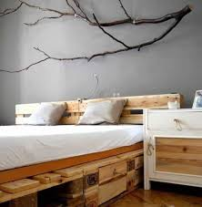 bedroom with tree wall branch decor ideas over pallet bed frame