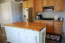 nice white island in kitchen with glossy wooden furniture fit with