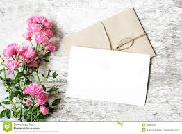 blank white greeting card and envelope with pink flowers
