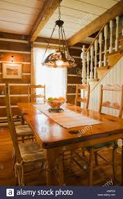 antique wooden dining table and high back chairs in the dining