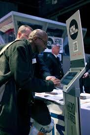 applying for a job at a hiring kiosk