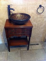 bathroom vanity made from an old sewing machine cabinet and hand