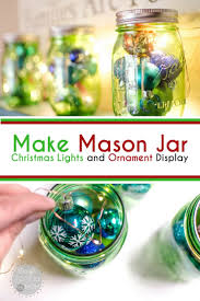 how to make mason jar lights with christmas lights mason jar christmas display brought to you by mom creating at home