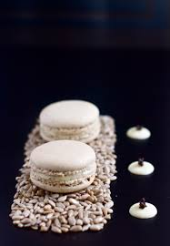 sunflower seed macarons with black truffle salted white chocolate