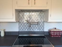 delta traditional pot filler sheridan with mirror backsplash from