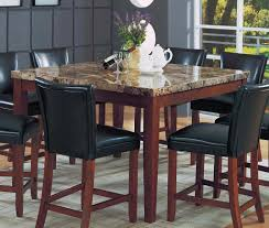 dining room with counter height table featured granite top and