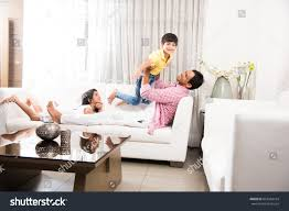 happy indian father playing son while stock photo 667364164