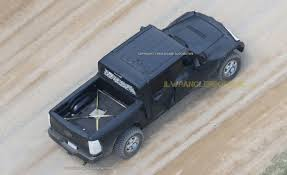 jeep wrangler pickup first glimpse new jeep wrangler pickup spied onallcylinders