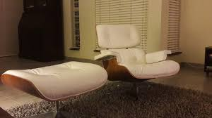 eames replica chair with foot bench