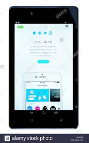 kik app android chat on kik app on an android tablet pc dorset uk stock