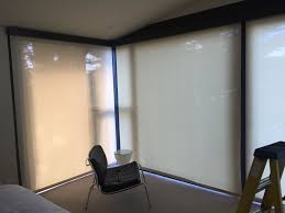 choosing between light and dark fabrics for your solar shades
