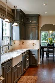 grey kitchen cabinets with brown wood floors cabinets with white granite countertops countertopsnews
