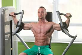 butterfly chest exercise on machine stock photo image of fitness