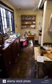 child plays in the period style kitchen at the the tudor house