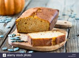 homemade pound cake baked in a loaf pan on a wooden board stock