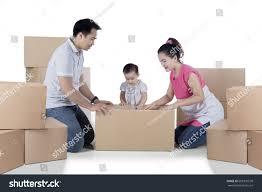 image asian family packing cardboard while stock photo 608301578
