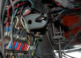 in our garage fixing decades of automotive wiring hacks
