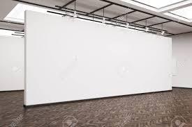 blank gallery wall side veiw of a large blank white wall in an art gallery dark