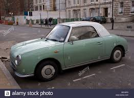 nissan white green and white two tone nissan figaro classic cult car stock