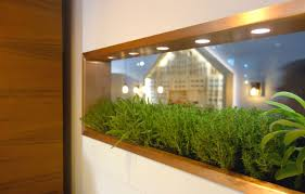 integrated indoor edible and ornamental indoor gardens at eurocucina