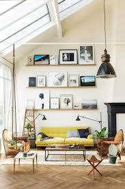 how to design with and around a yellow living room sofa high ceiling living room with yellow count and pictures on ledge