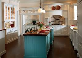 decor white kitchen cabinets and teal island with pendant