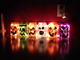 good use for my used up yankee candle jars halloween
