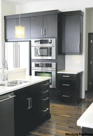 espresso kitchen cabinets with white countertops let there be light winnipeg free press homes espresso